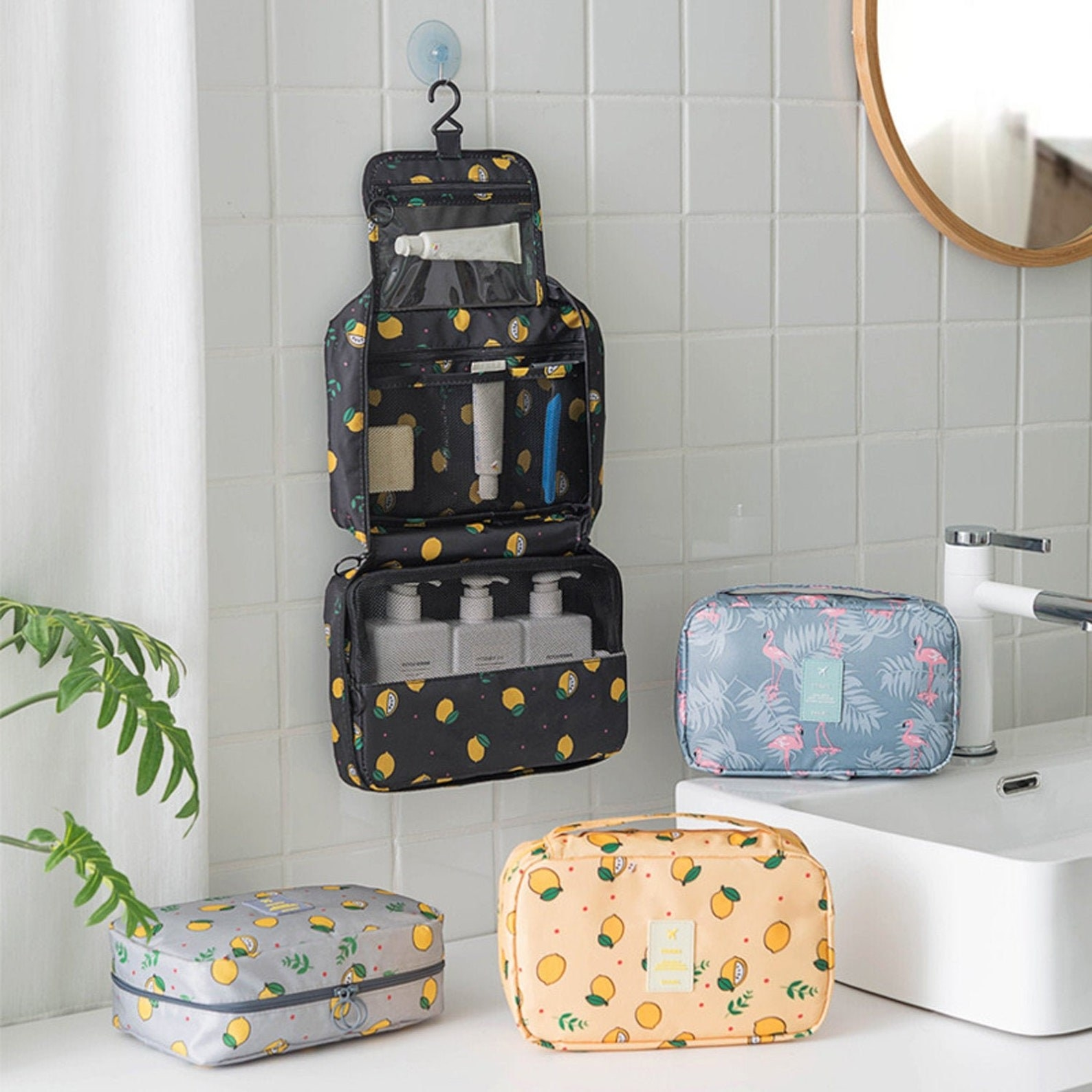 A hanging zippered pouch undone to show bottles, toothbrush and accessories inside