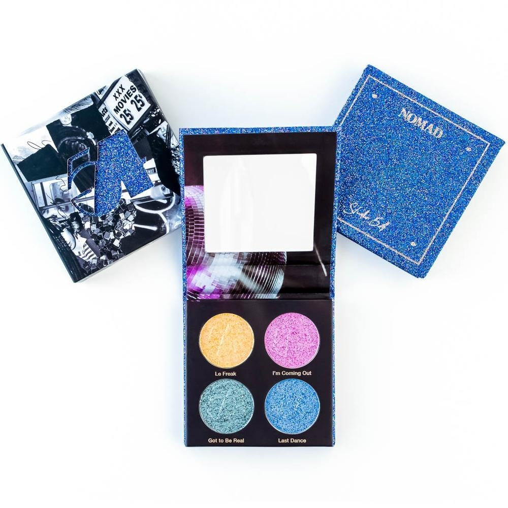 The palette with four glitter shadows: gold, pink, blue, and green