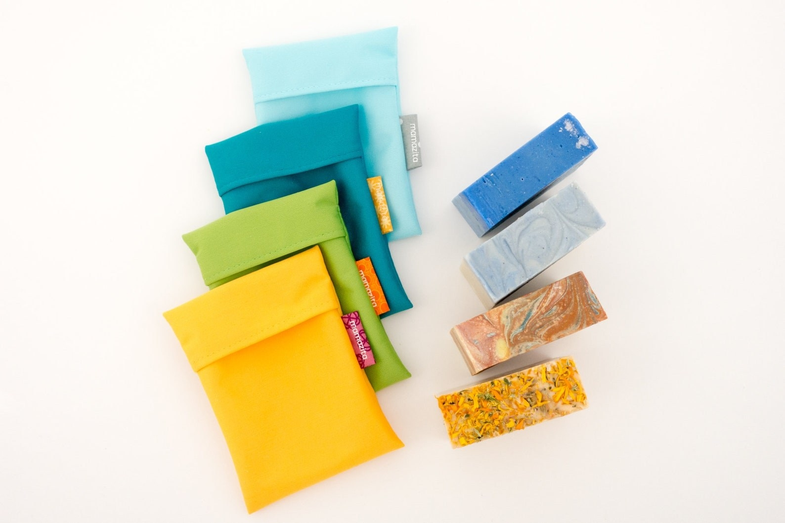 Fabric soap holders in yellow, green, and blue