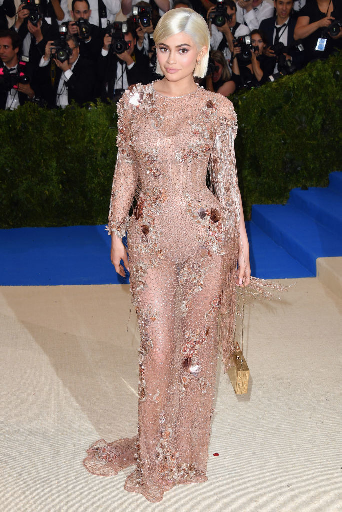 """Kylie Jenner attends the """"Rei Kawakubo/Comme des Garcons: Art Of The In-Between"""" Costume Institute Gala in a sheer long-sleeved floor-length with metallic embelishments"""