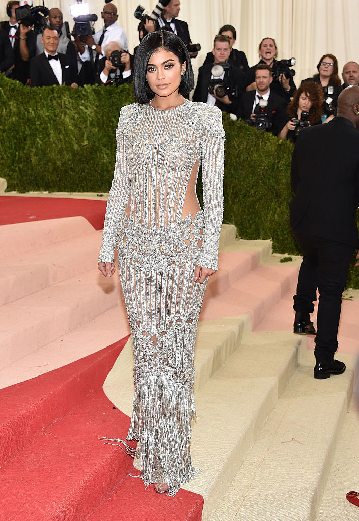 Kylie Jenner attends the 'Manus x Machina: Fashion In An Age Of Technology' Costume Institute Gala in a a sparkly long-sleeved dress with see-through panels