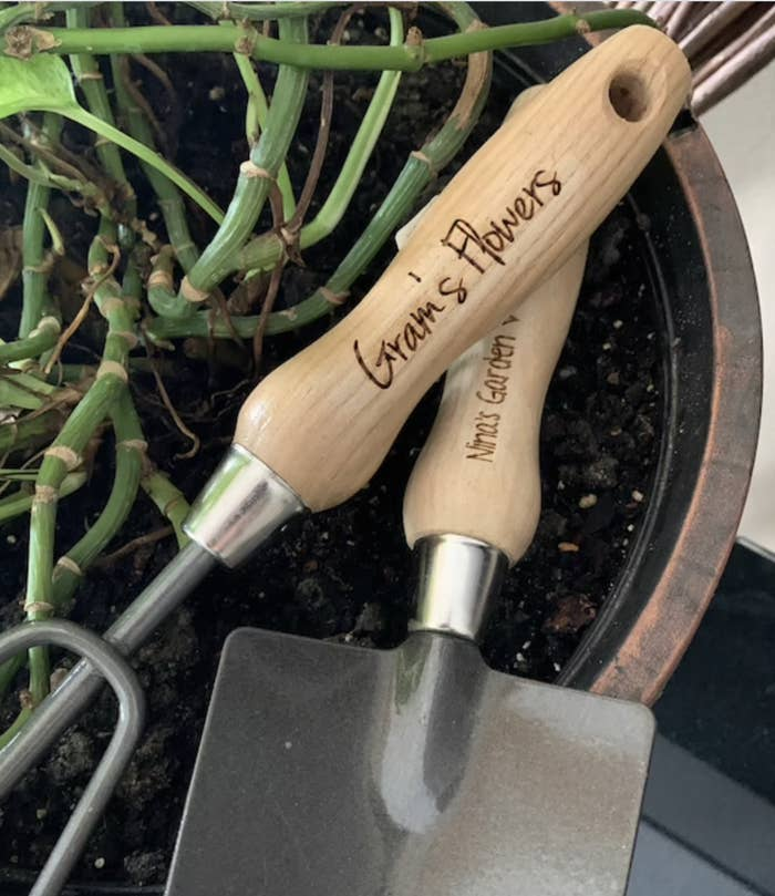 The tools are shown with the handle engraved with Gram's Flowers