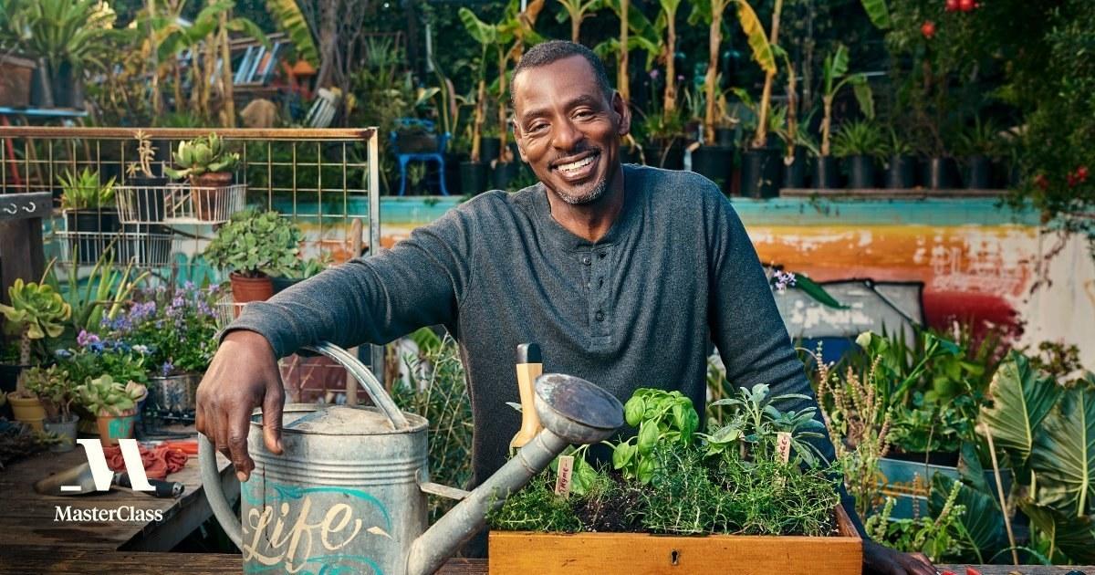Ron Finley poses in his garden