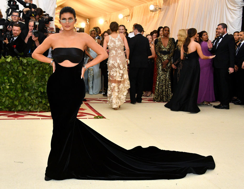 Kylie Jenner attends the Heavenly Bodies: Fashion & The Catholic Imagination Costume Institute Gala in a strapless, floor-length dress and sunglasses