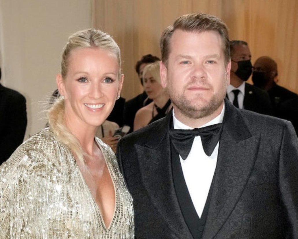 A close up ofJulia Carey and James Corden as they pose for the camera