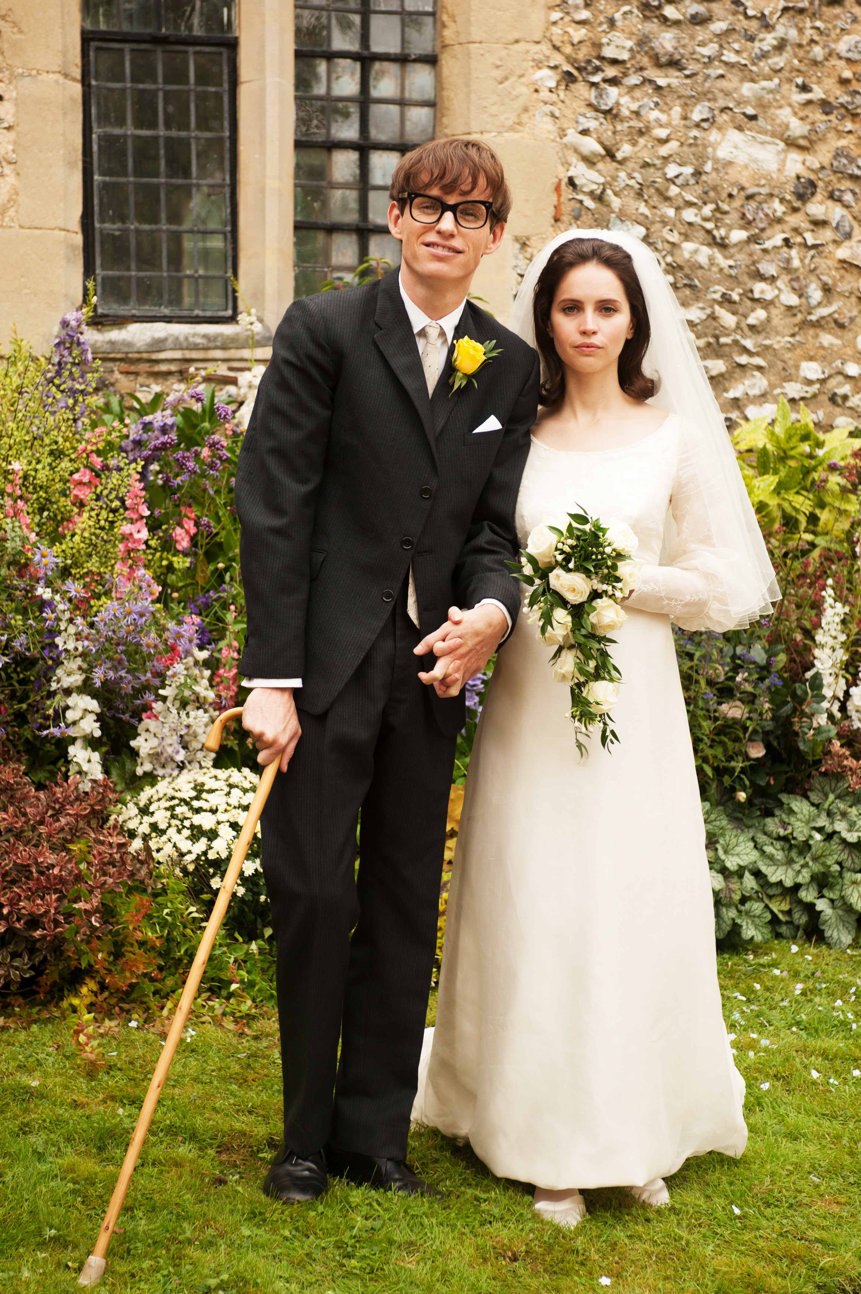 Steve Hawking and Jane Hawking wearing a suit and a wedding dress, respectively, on their wedding