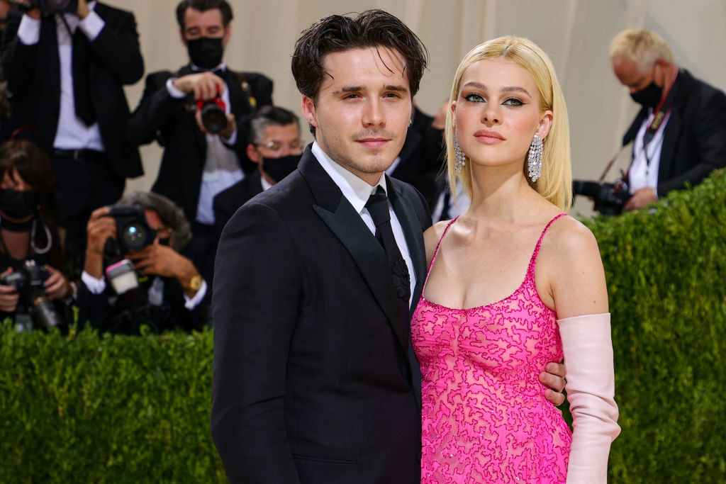A close up ofBrooklyn Beckham and Nicola Peltz as they pose for the camera at the Met Gala