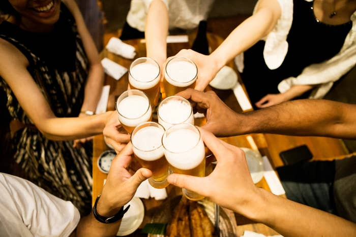 Clinking beverage cups in celebration