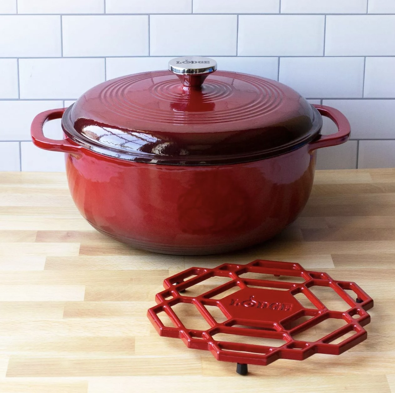 a red dutch oven in front of a dutch rest