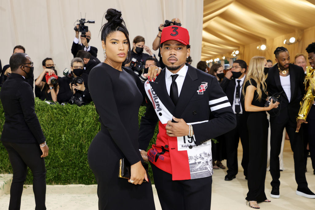 A close up ofKirsten Corley and Chance the Rapper as they pose on the red carpet of the Met Gala