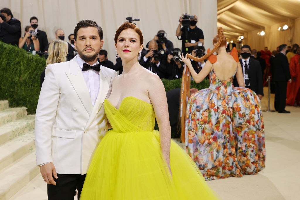 A close up ofKit Harington and Rose Leslie as they pose on the Met Gala red carpet