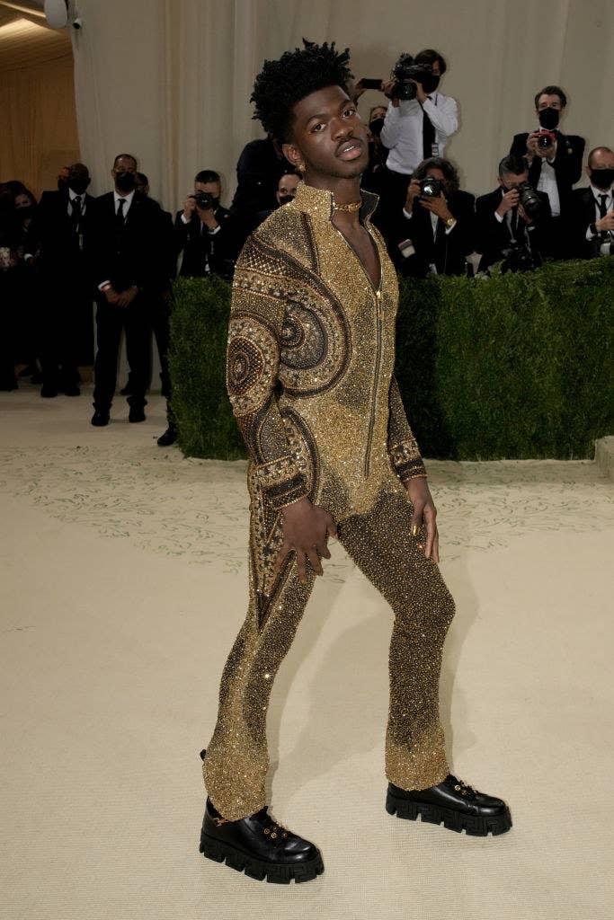 Lil Nas X wears a long sleeve glittery jumpsuit
