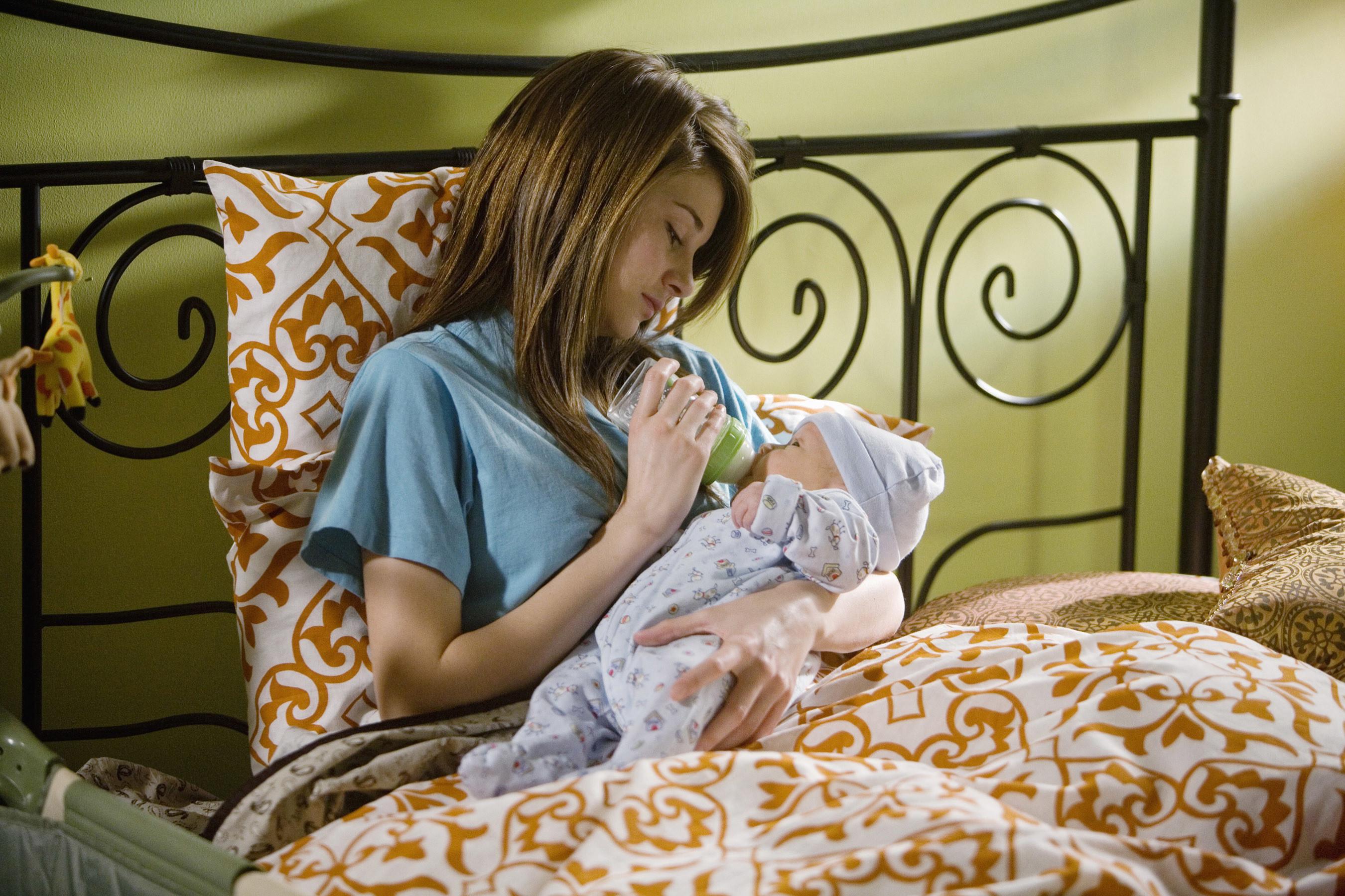 Shailene Woodley in Secret Life feeding a bottle to a baby