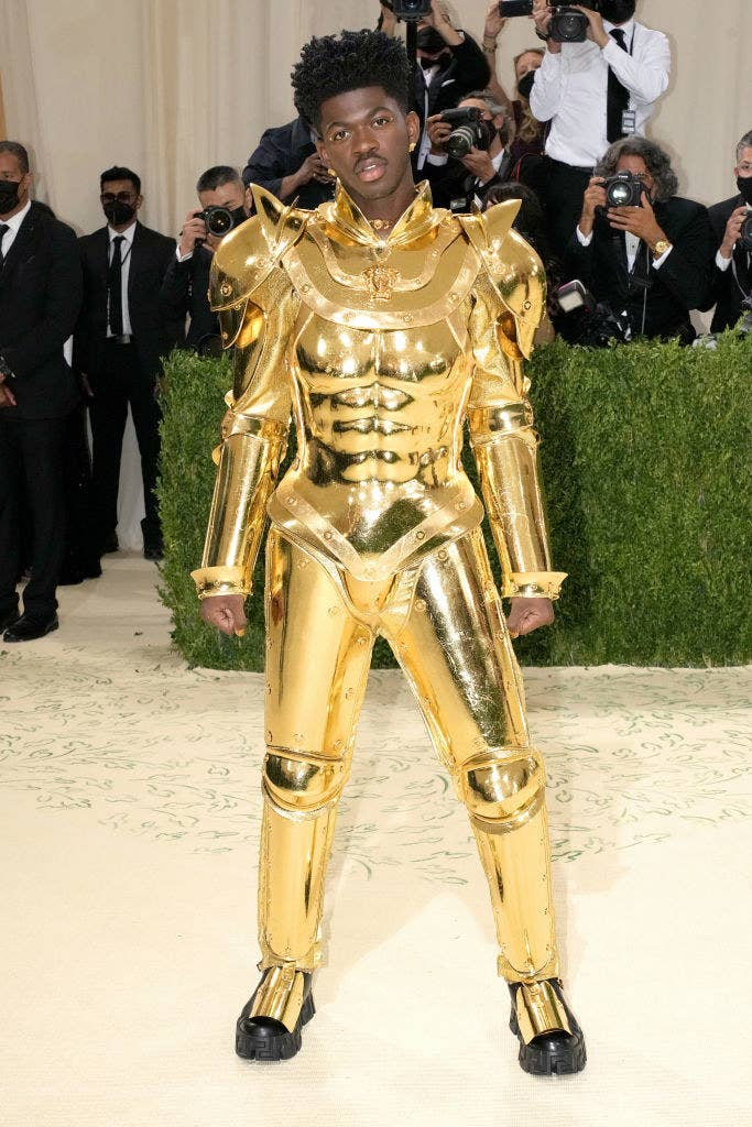 Lil Nas X wears a robotic gold plated suit of armor at the Met Gala