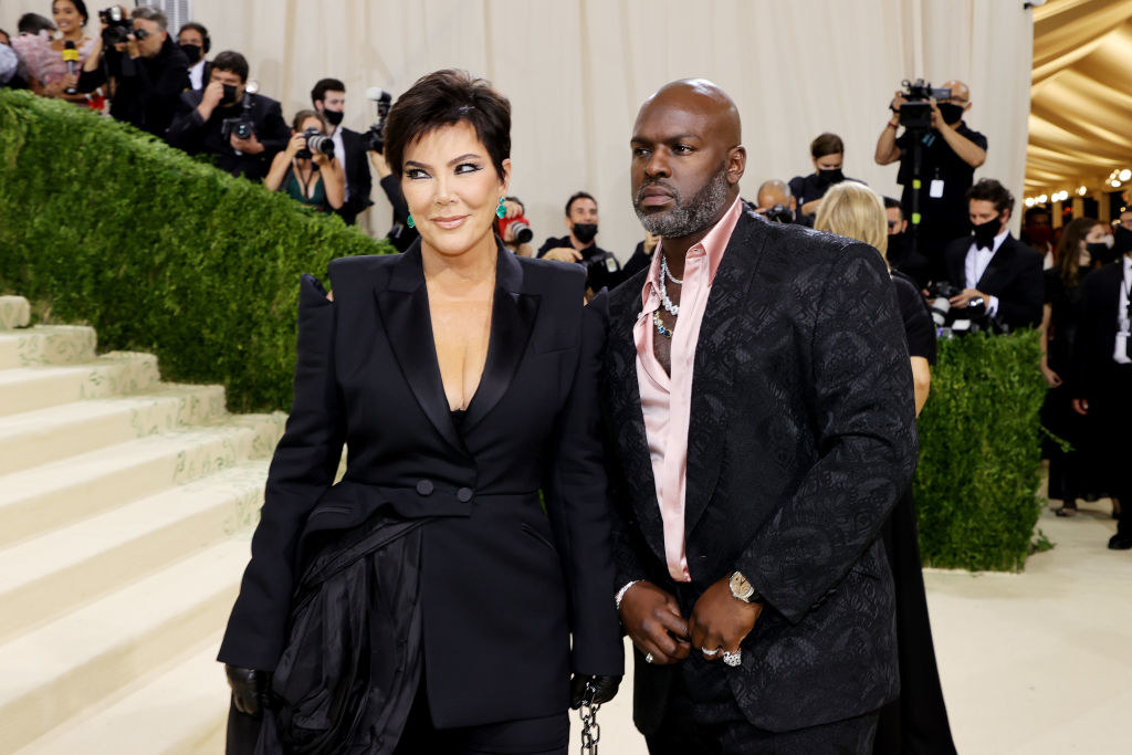 A close up ofKris Jenner and Corey Gamble as they pose on the Met Gala red carpet