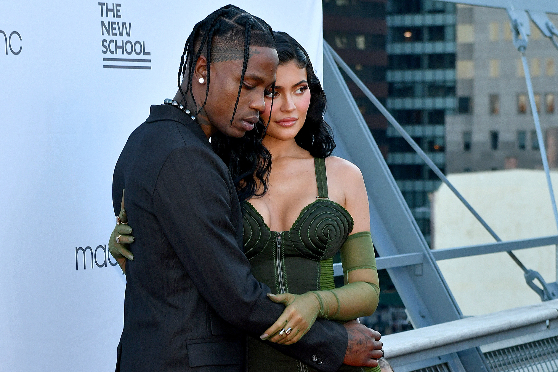 Scott puts his arm around Jenner's torso at a red carpet event