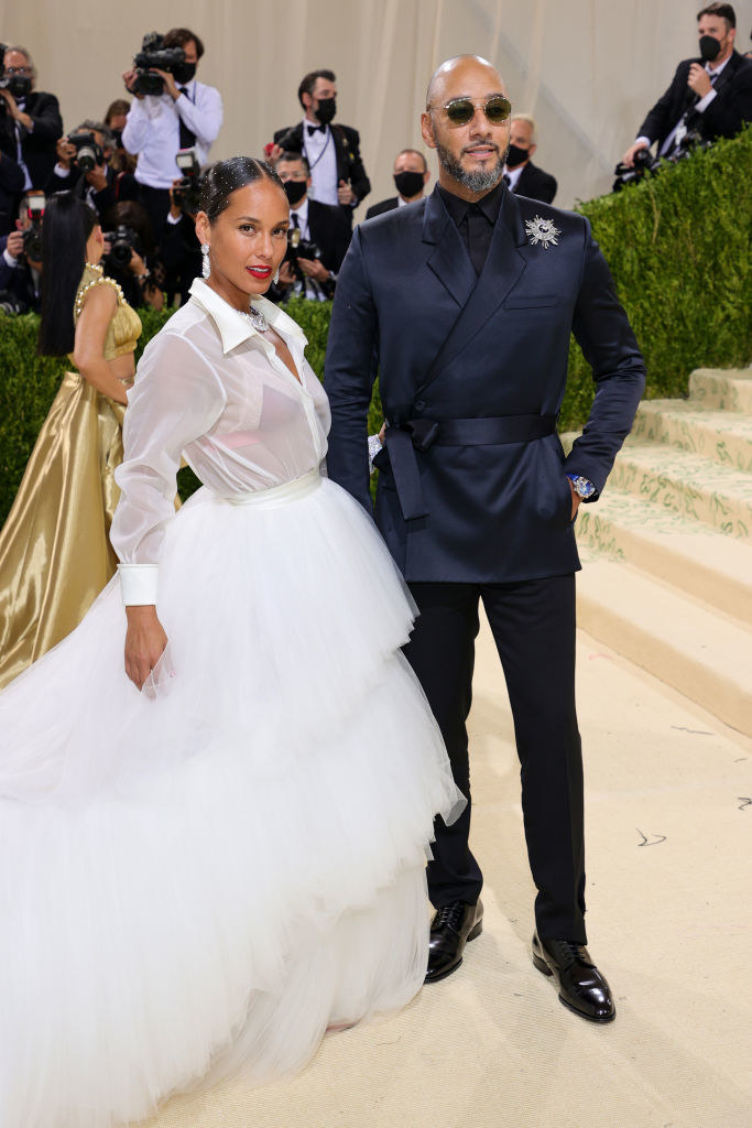 A close up ofAlicia Keys and Swizz Beatz as they pose on the Met Gala red carpet