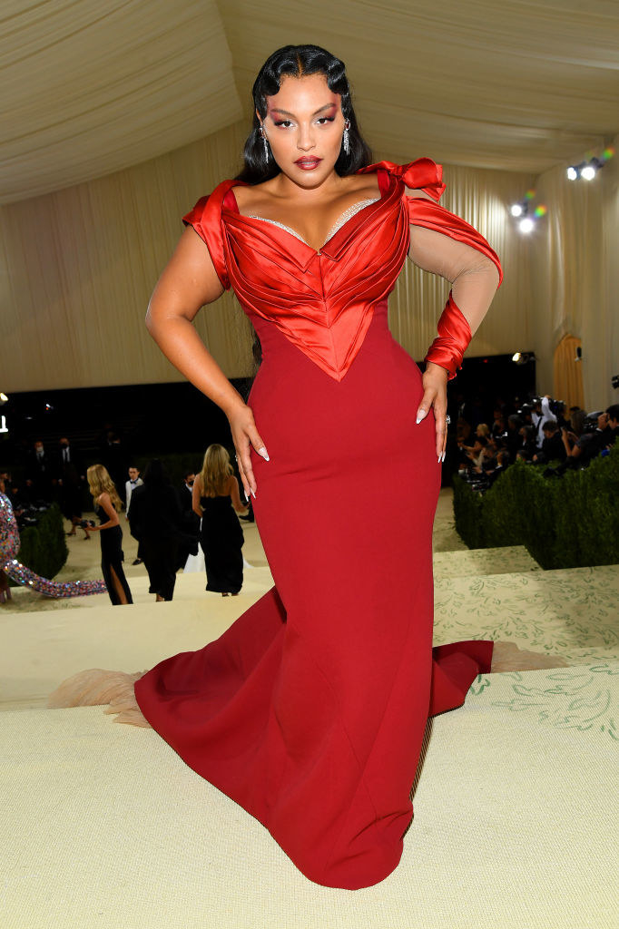 Paloma Elsesser wears a floor length tight bodice gown