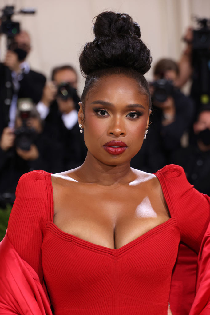 A close up ofJennifer Hudson as she shows off her natural makeup and bold lipstick