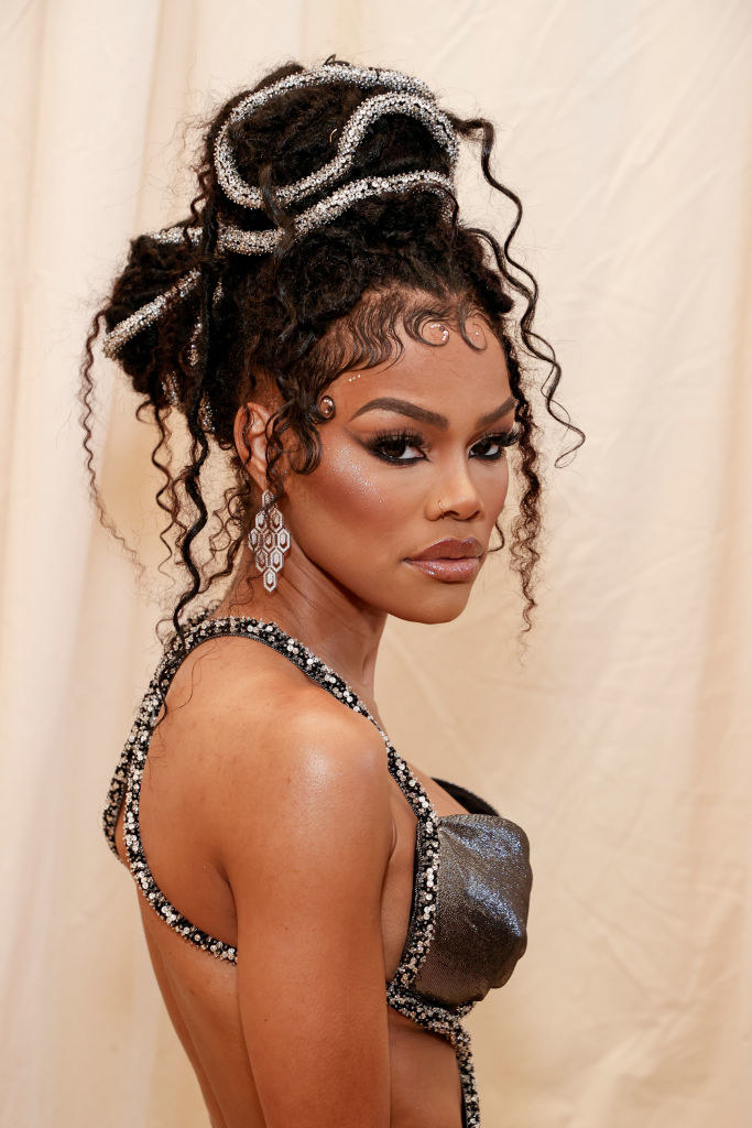 A close up ofTeyana Taylor as she shows off her dark eye makeup and dreadlocks