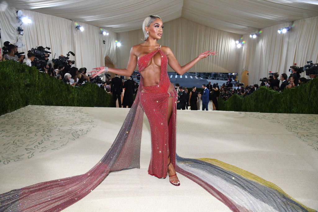 Saweetie wears a gown with a cut out on her torso with a long train