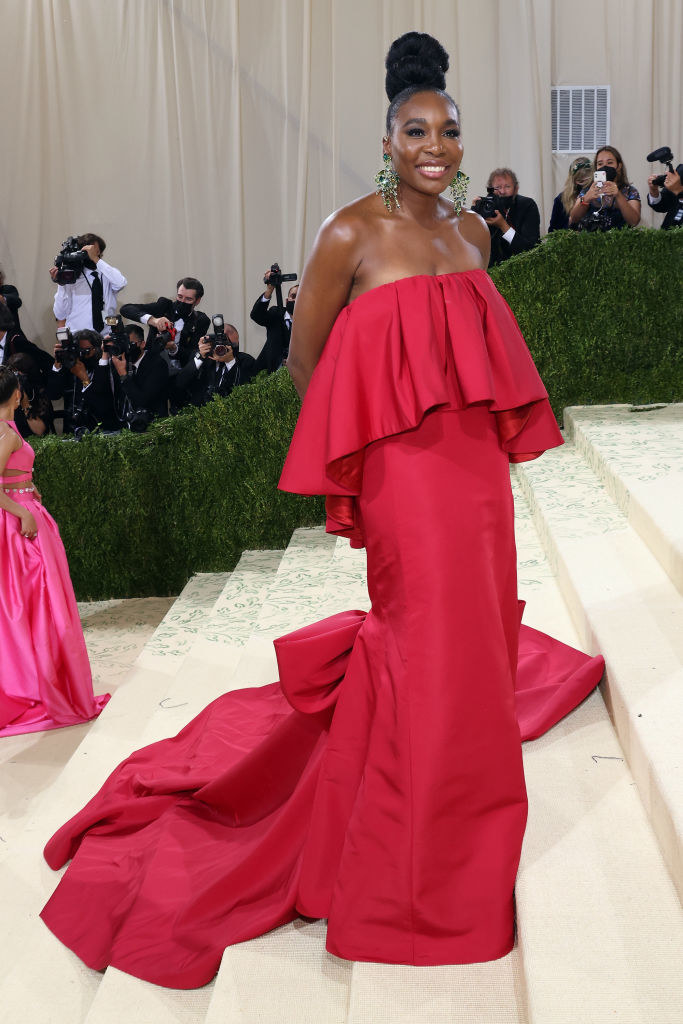 Venus Williams wears a strapless brightly colored gown with a long train