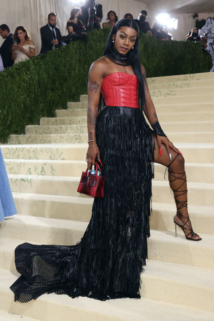 Sha'Carri Richardson wears a strapless gown floor length gown with a slit up the thigh