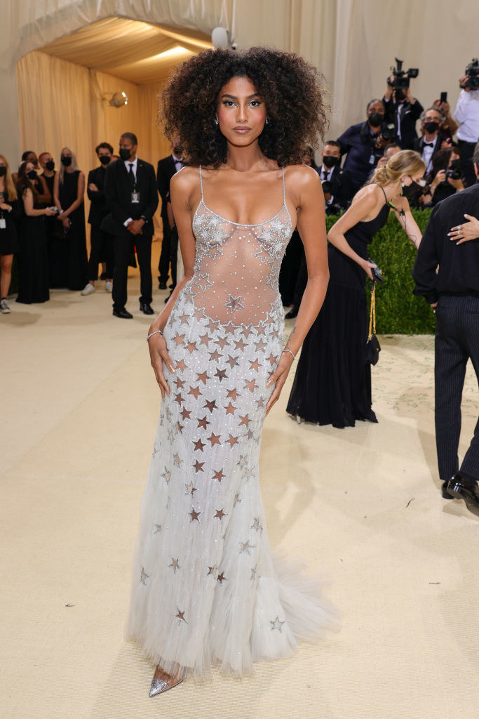 Imaan Hammam wears a thin strap glittery gown with stars embroidered on it