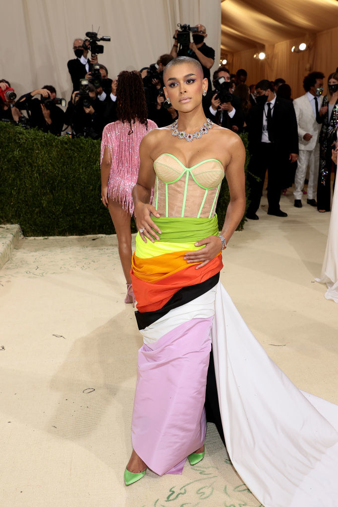 Jordan Alexander wears a strapless neon colored bodice tucked into a skirt that has multiple colors in it