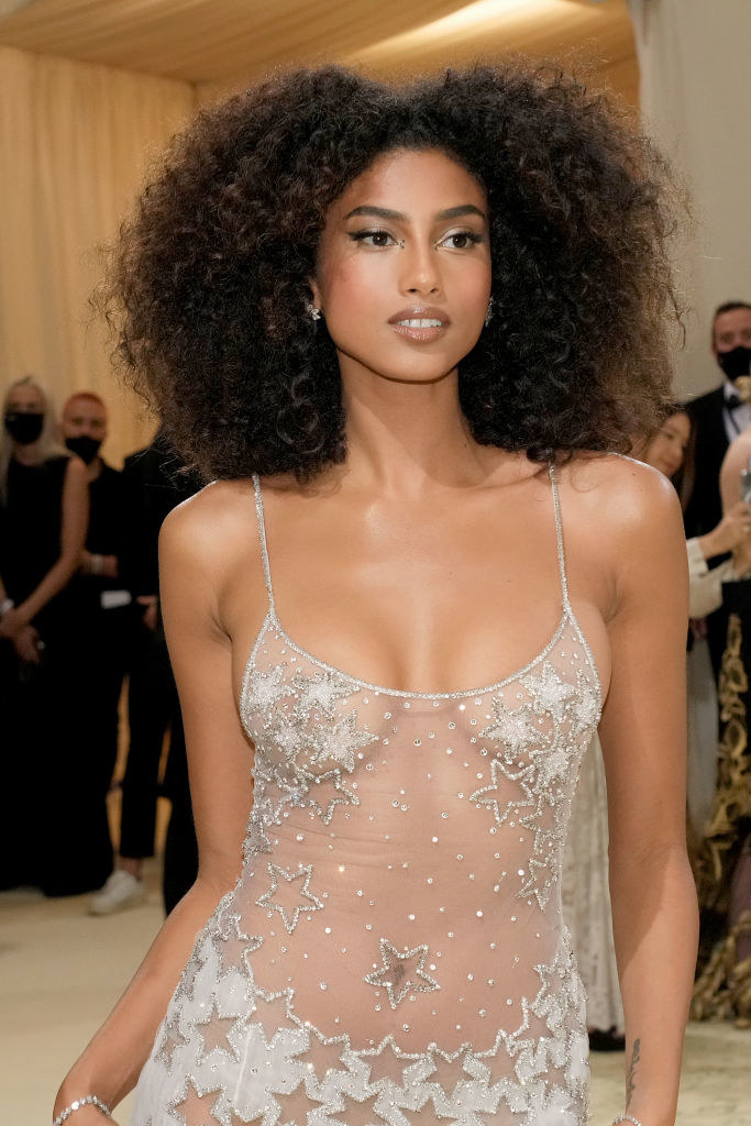 A close up of Imaan Hammam as she shows off her natural makeup