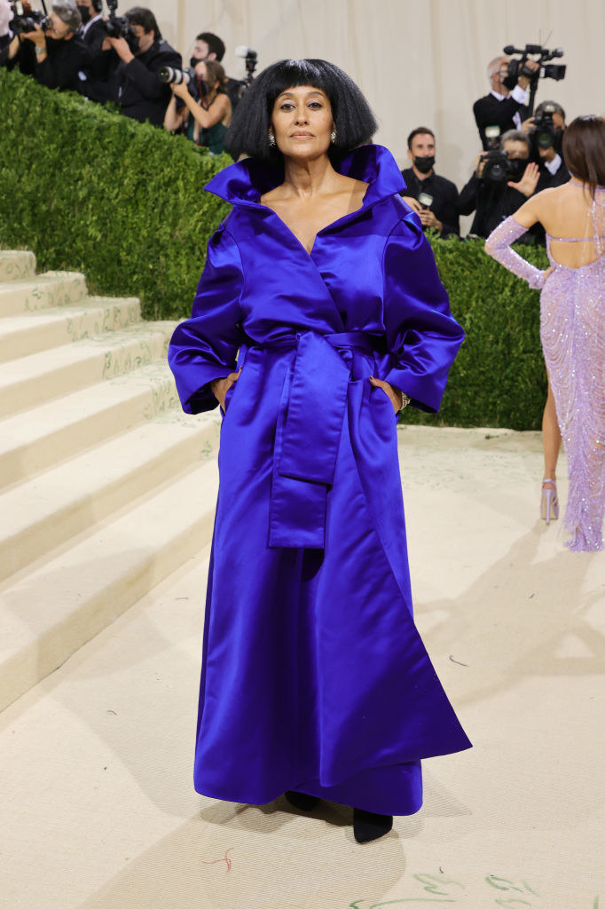 Tracee Ellis Ross wears a long sleeve high collared brightly colored gown