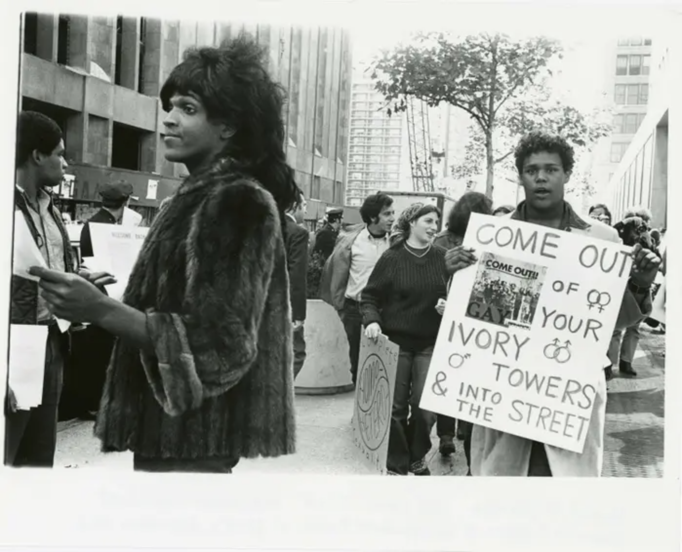 """A 1970 photo of Marsha P. Johnson handing out flyers in support of Gay Students at NYU is seen here courtesy of the New York Public Library's """"1969: The Year of Gay Liberation"""" exhibit"""