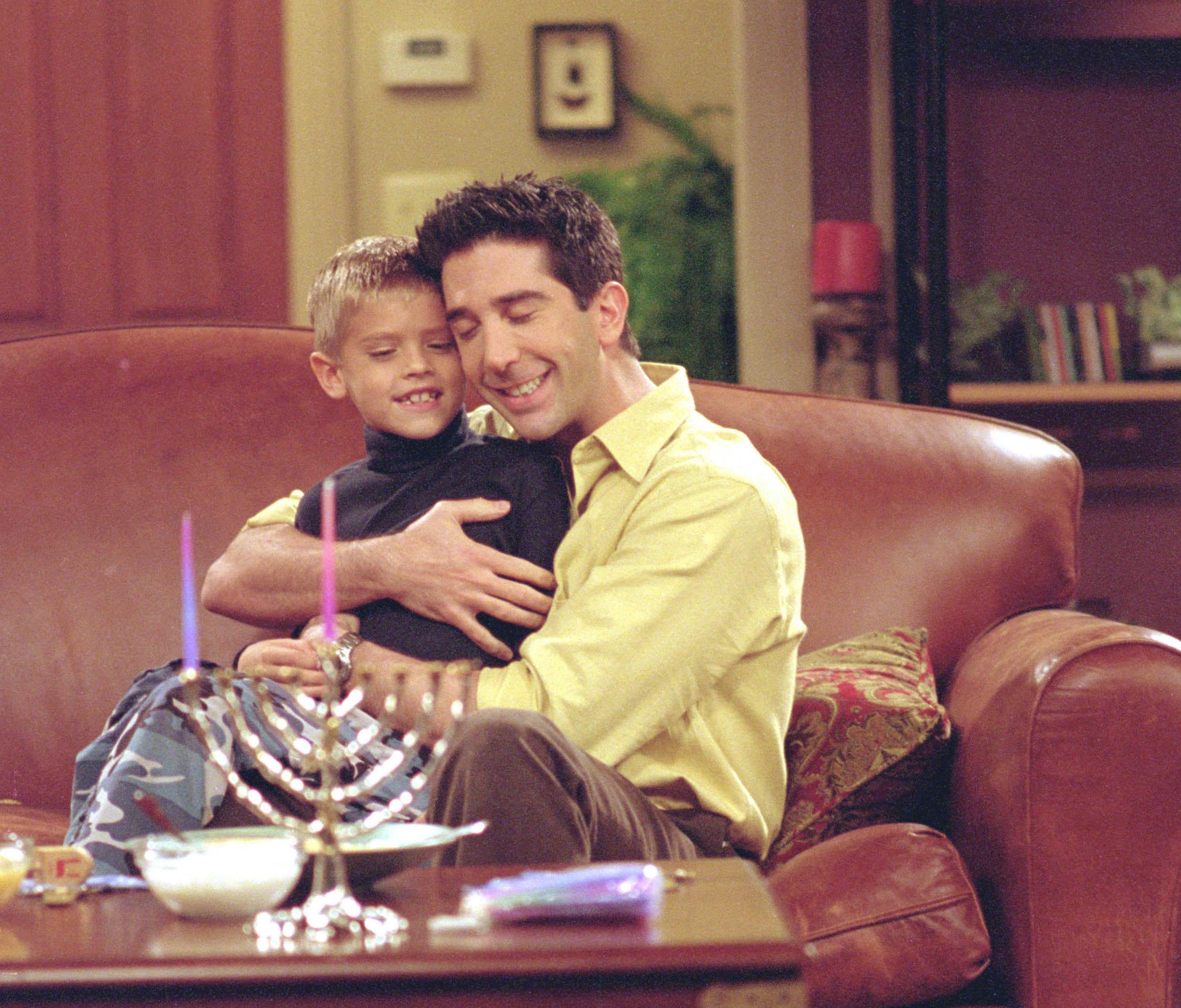 Ross hugging Ben.