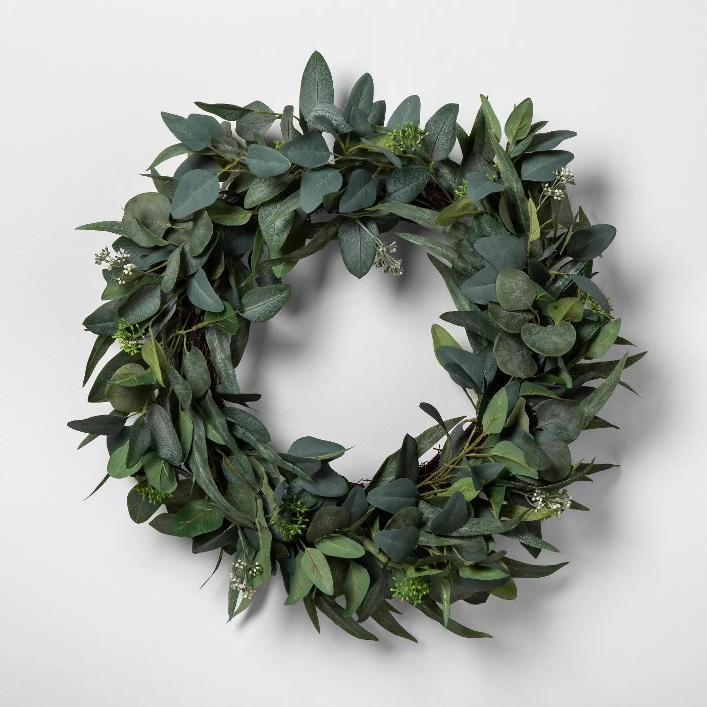 leafy green wreath on a white door