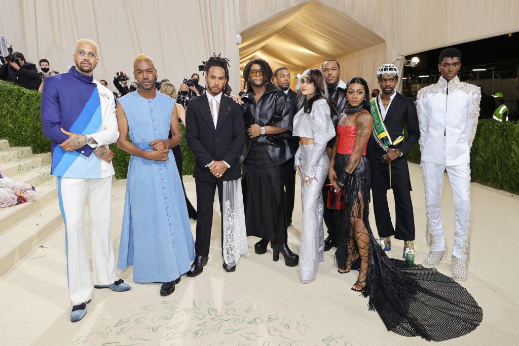 Left to right: Lewis Hamilton, Law Roach, Kehlani, Sha'Carri Richardson, Theophilio Edvin Thompson and Alton Mason pose on the Met Gala steps