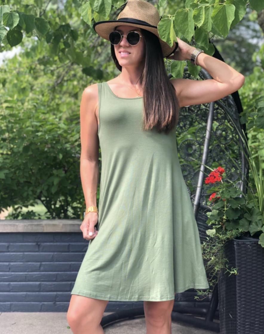 A reviewer wearing their dress