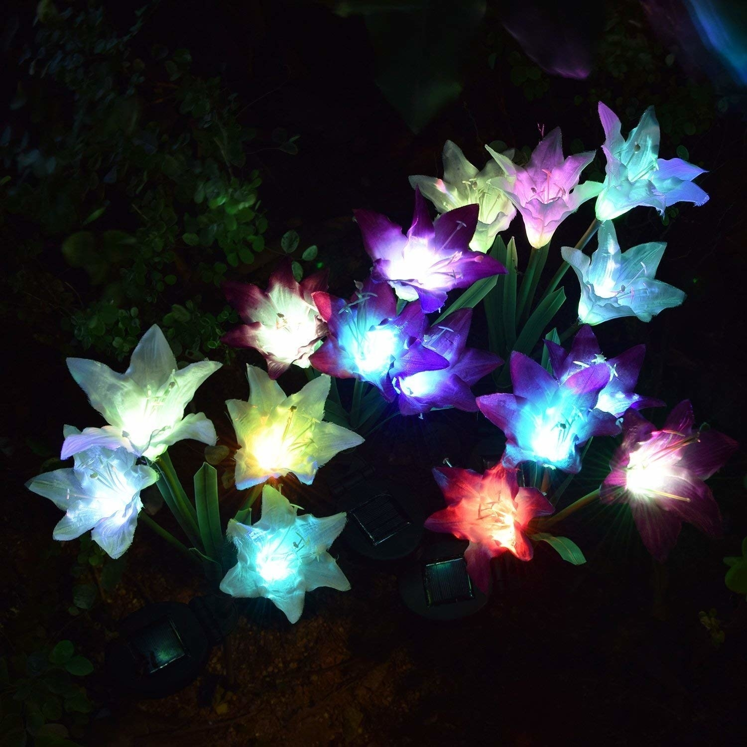 an array of light up flowers glowing at night