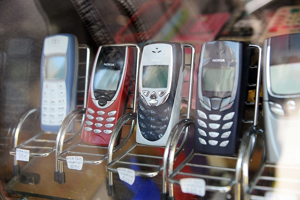 Cell phones from the early 2000s on display