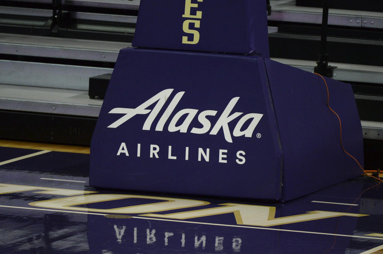 An Alaska Airlines logo on a basketball court