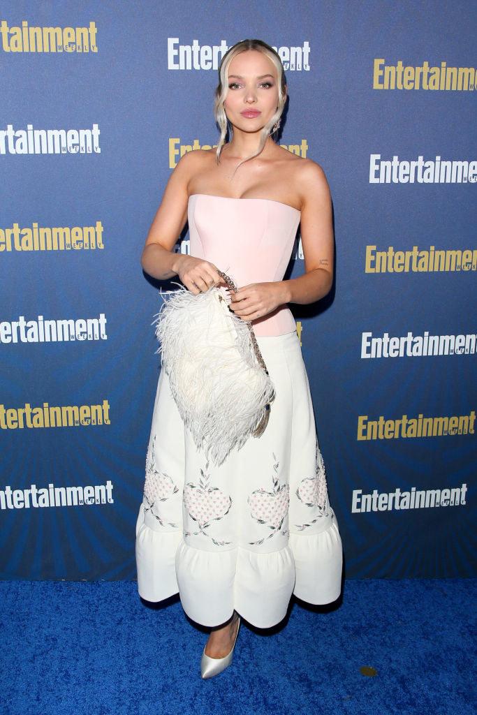 long, linen skirt and a pastel sleeveless top