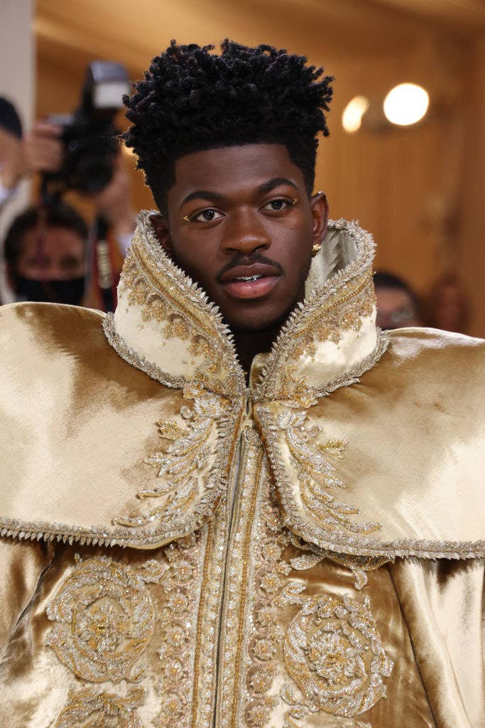 Lil Nas X in a printed cape