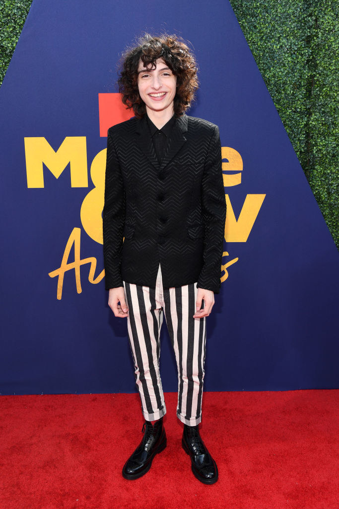 suit top and striped pants
