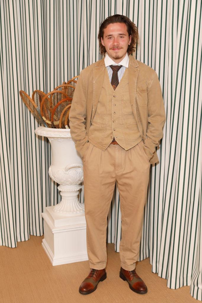 light-colored, classic suit with a unique twist