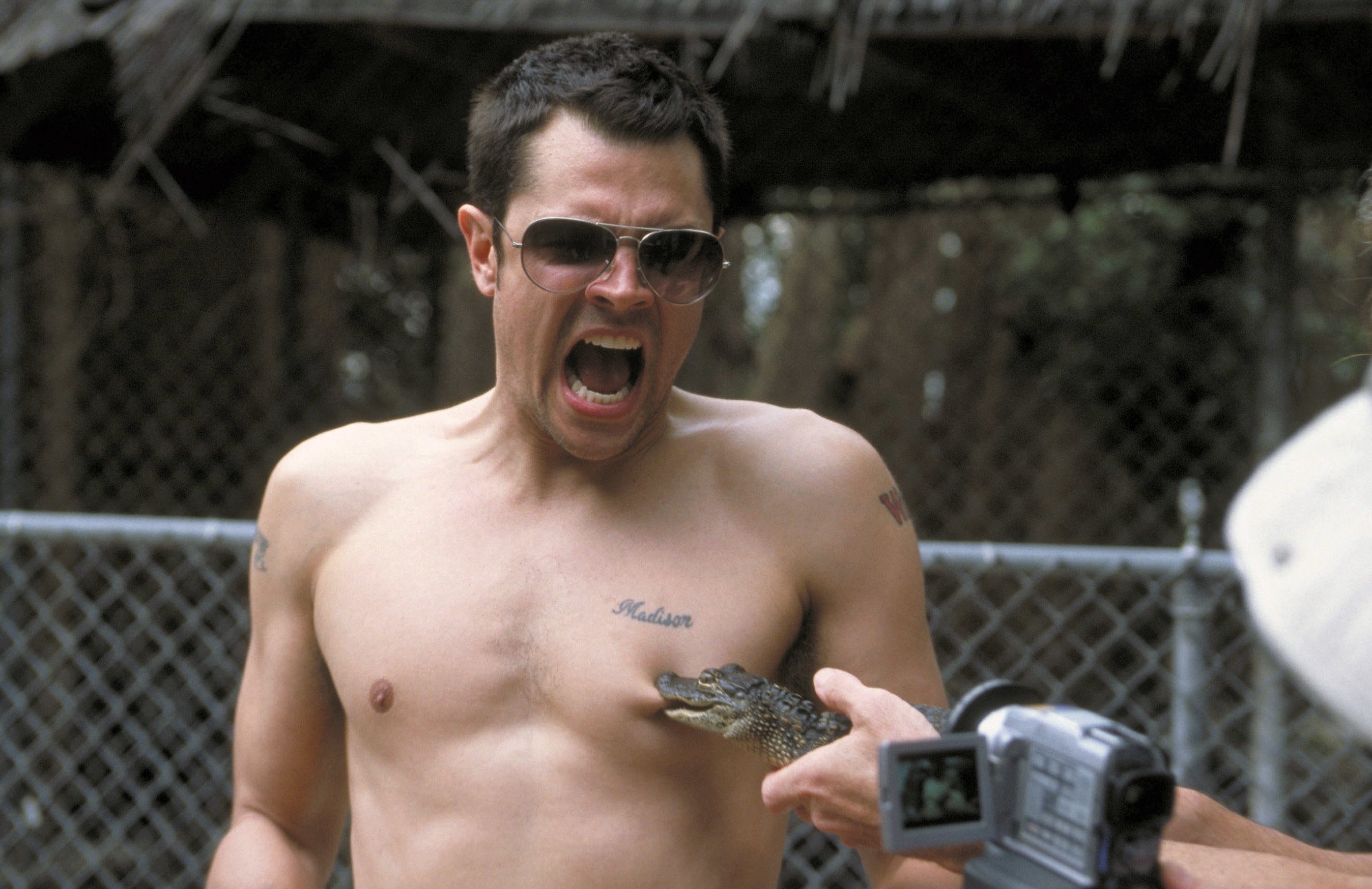 Johnny Knoxville getting bitten by the mini alligator