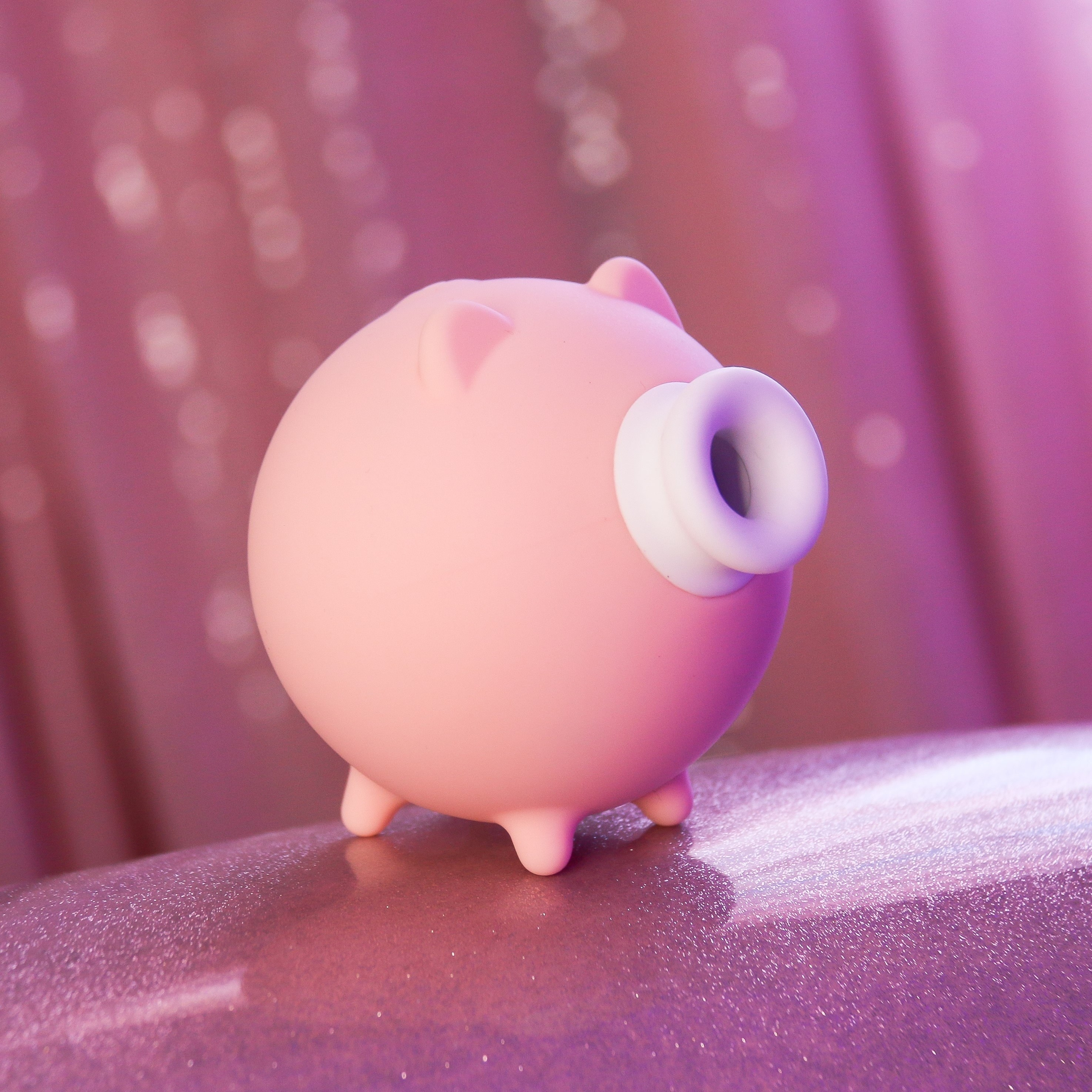 Pink pig-shaped suction vibrator
