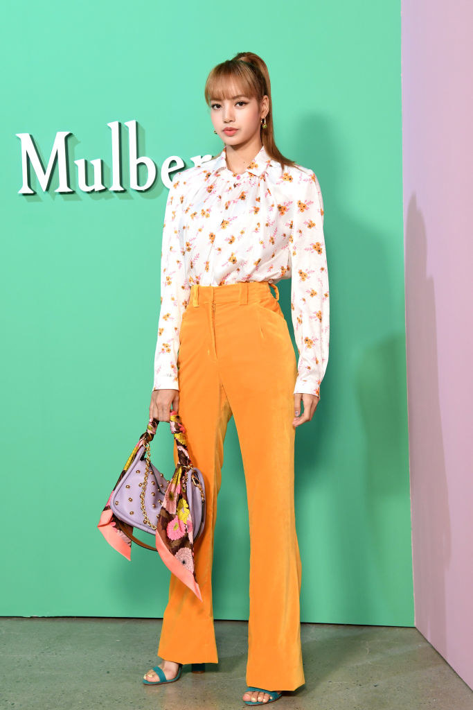 high waisted pants and a floral blouse