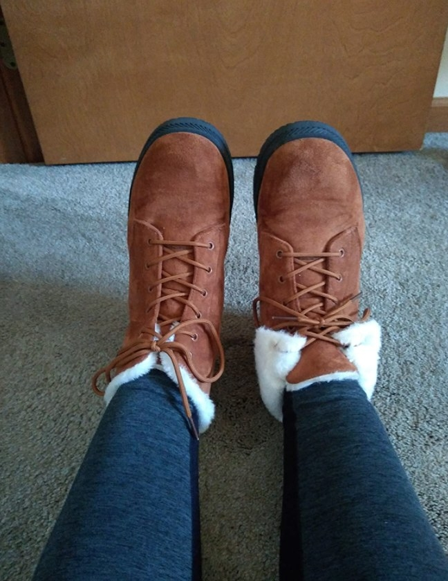 a reviewer wearing the boots in brown