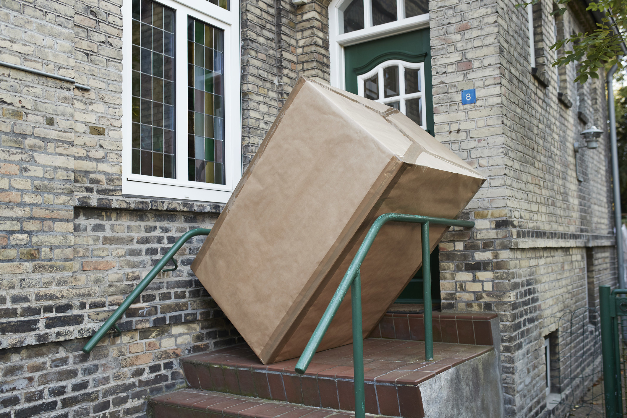 A large box at the top of some stairs