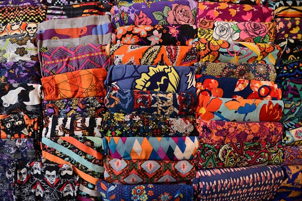 Hundreds of pairs of folded, colorfully printed leggings