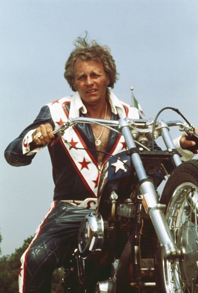 Evel Knievel poses on his motorcycle